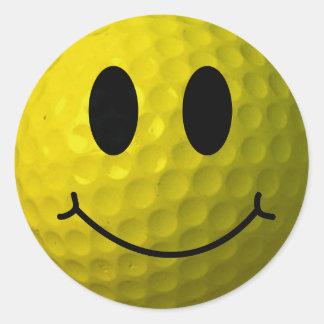 Boule de golf souriante de visage sticker rond