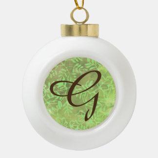 Boule En Céramique Le batik part de la lettre rustique verte G de