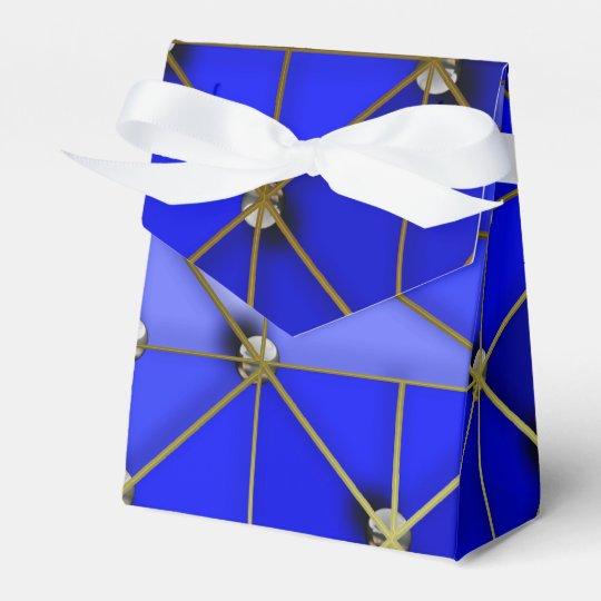 Boules d'or et d'argent sur le bleu boite de faveur