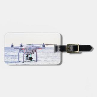 Bourdon de vol à la côte au-dessus de la mer étiquette pour bagages