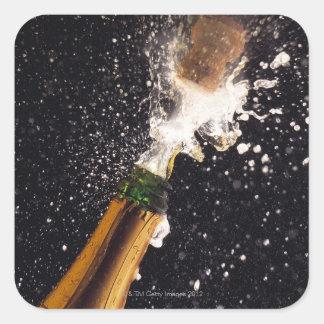 Bouteille de explosion de champagne sticker carré