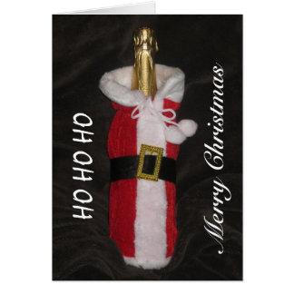 Bouteille de vin dans la carte de Joyeux Noël de