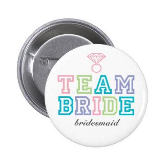 Bouton de jeune mariée d'équipe badge
