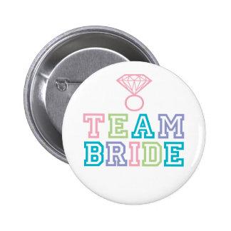 Bouton de jeune mariée d'équipe badges