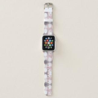 Bracelet Apple Watch Rose et parties scintillantes grises regardant le
