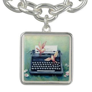 Bracelet argenté de charme de machine à écrire et