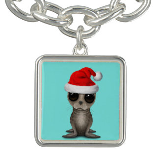 Bracelet Avec Breloques Bébé phoque utilisant un casquette de Père Noël