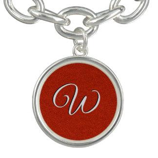 Bracelet rouge d'initiale de parties scintillantes