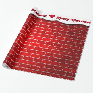 Brique rouge avec la dérive de neige - dessus de papier cadeau noël