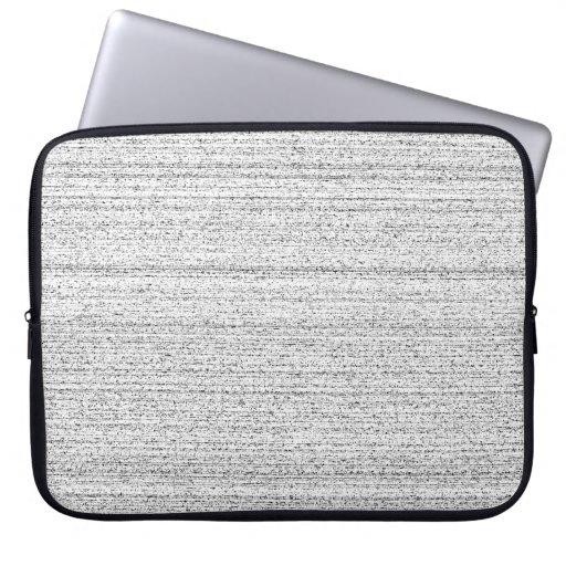 Bruit blanc. Grain noir et blanc de Milou Housses Pour Ordinateur Portable