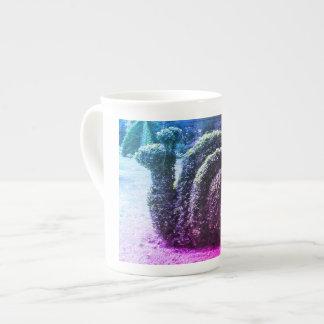 Buisson coupé par ornamental topiaire d'escargot mug