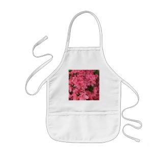 Buisson fleurissant rose lumineux au printemps tablier enfant