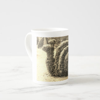 Buisson ornemental topiaire de sépia d'escargot de mug