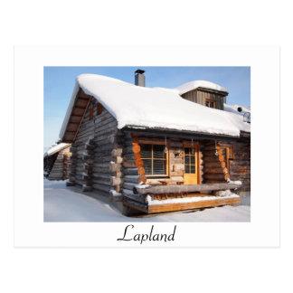 cabine de rondin Neige-couvert en carte postale de