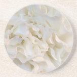 Caboteur floral blanc de boisson dessous de verre