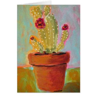 Cactus de Noël dans une carte de voeux de blanc de