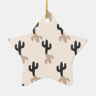 Cactus noirs dans le désert rose ornement étoile en céramique