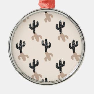 Cactus noirs dans le désert rose ornement rond argenté