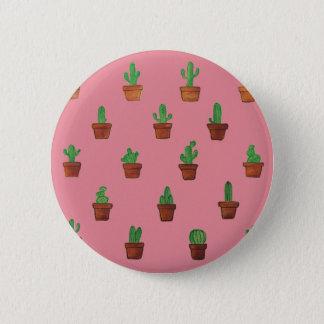 Cactus sur le bouton rose d'arrière - plan badges