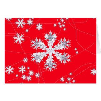 Cadeaux rouges de dérive de flocons de neige par cartes