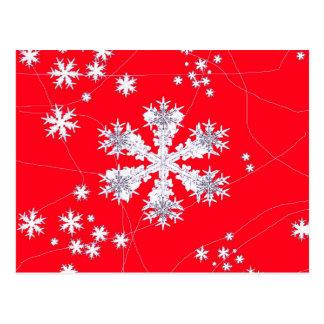 Cadeaux rouges de dérive de flocons de neige par carte postale