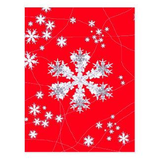 Cadeaux rouges de dérive de flocons de neige par cartes postales