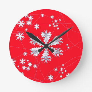 Cadeaux rouges de dérive de flocons de neige par pendule murale