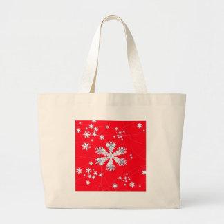 Cadeaux rouges de dérive de flocons de neige par sac