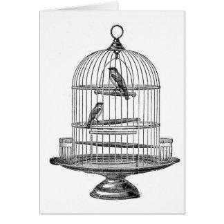Cage à oiseaux vintage avec le carte pour notes