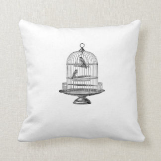 Cage à oiseaux vintage avec le coussin d'oiseaux…