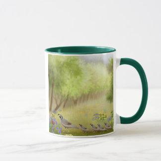 Cailles dans une tasse de sonnerie de pré