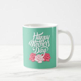 Calligraphie heureuse du jour de mère avec des mug