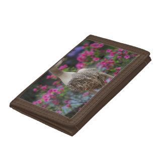 Canard en bois avec des fleurs