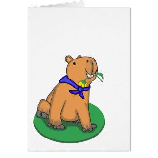 Capybara tenant la carte de voeux de fleur, vierge