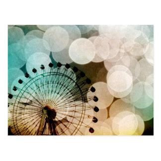 Carnaval bleu de roue de ferris de bokeh en pastel carte postale