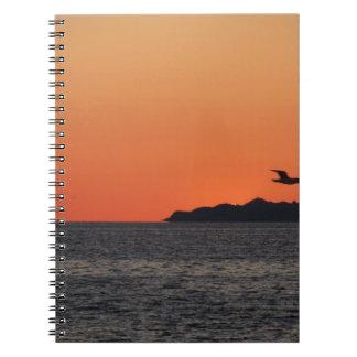 Carnet Beau coucher du soleil de mer avec la silhouette