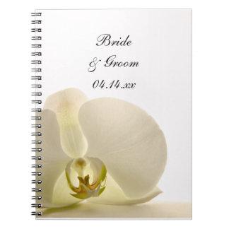 Carnet Fleur d'orchidée sur le mariage blanc