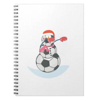Carnet Le football de bonhomme de neige tamponnant la