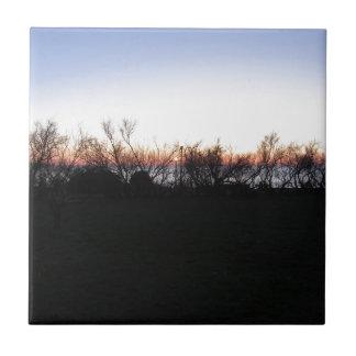 Carreau Coucher du soleil de mer avec la silhouette