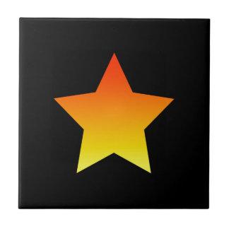 Carreau Étoile orange lumineuse sur le noir