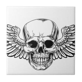 Carreau La gravure sur bois vintage à ailes en crâne a