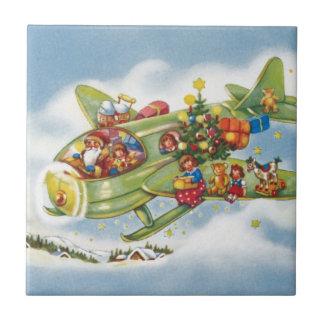 Carreau Noël vintage, le père noël pilotant un avion
