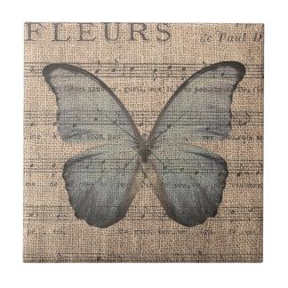 Carreau Papillon bleu sur la musique de feuille vintage