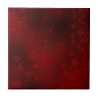 Carreau rouge, petites fleurs asiatiques sensibles sur un