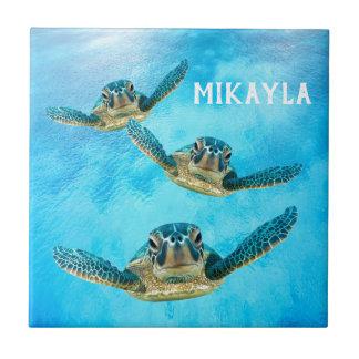 Carreau Trois tortues de mer de bébé nageant