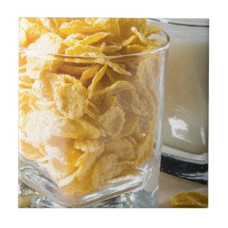 Carreau Verre de céréale sèche et un verre de lait