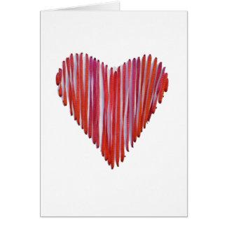 Carte de coeur piquée par rouge