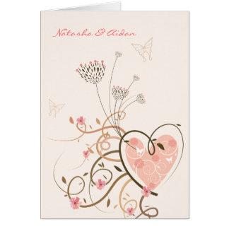 Carte de mariage rose de remous d'amoureux et de