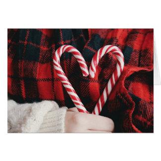 Carte de Noël de coeur de sucre de canne