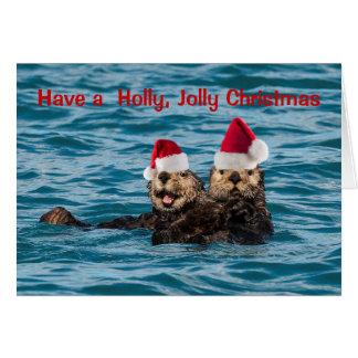 Carte de Noël de faune, loutres utilisant des